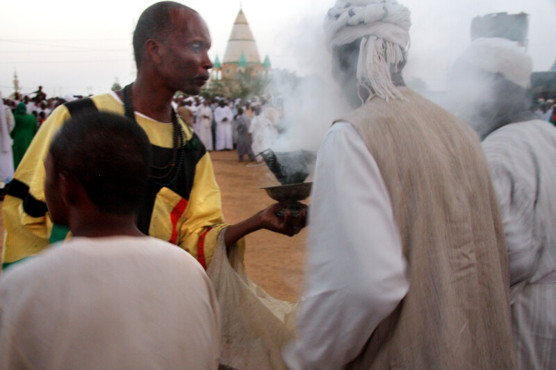 The passing of incense around the devotees