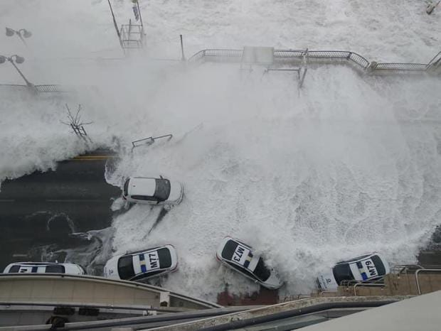 MalDia Police patrol cars did not escape the fury of the storm at St Julians