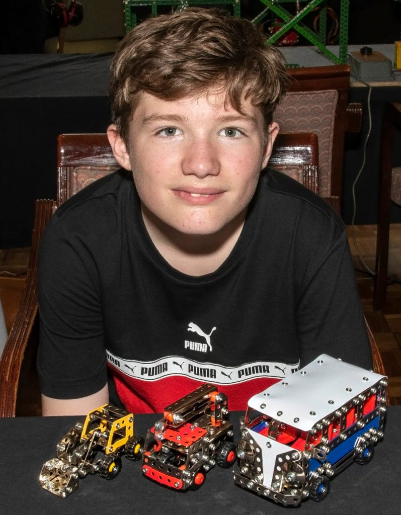 Pic Teenager James with some of the vehicles hes constructed
