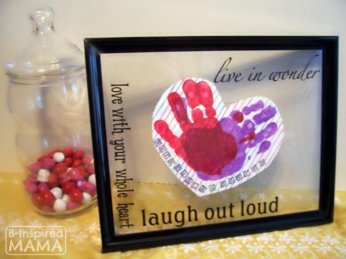 A Preschool Valentines Craft - Framed Handprint Hearts at B-Inspired Mama