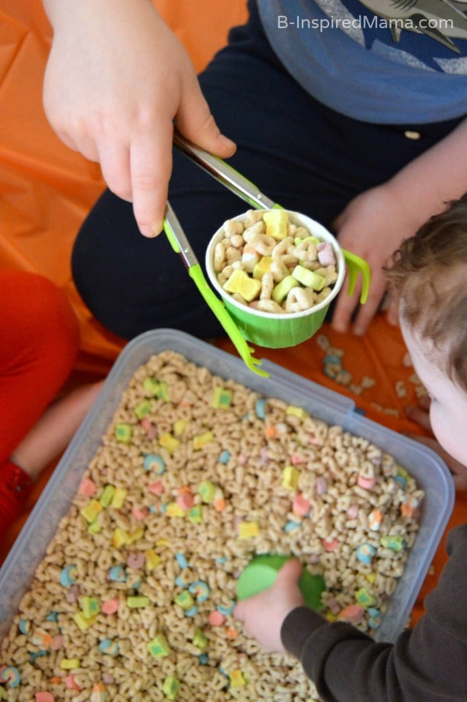 Using Tongs for our Cereal Sensory Play at B-Inspired Mama
