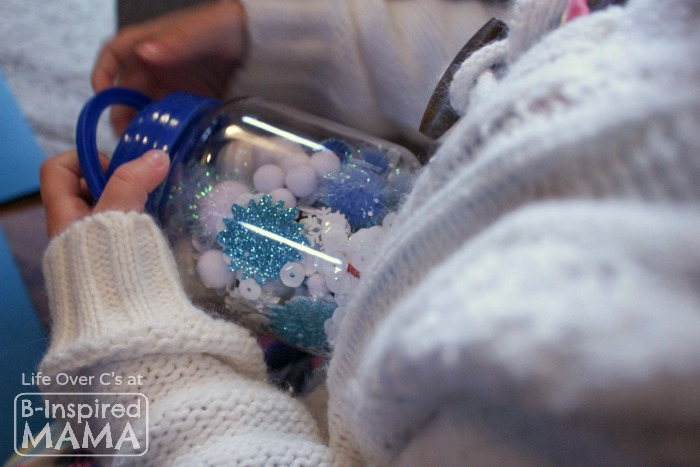 Easy DIY Toys - Playing with a Simple Snowflake I Spy Jar - B-Inspired Mama