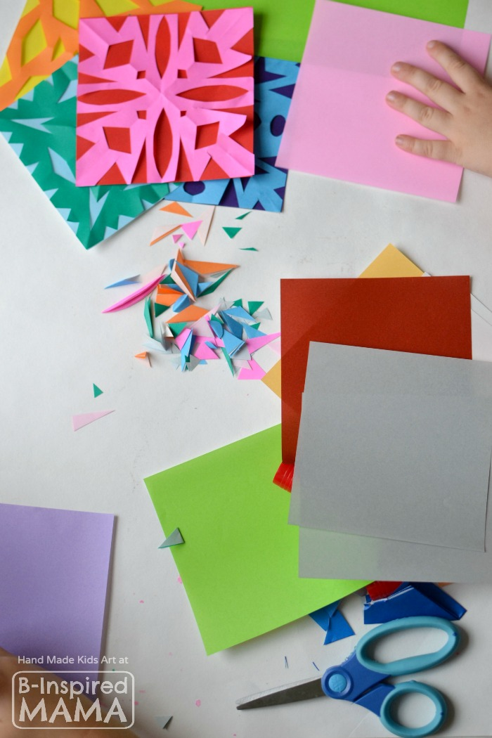 Making a Colorful Kids Art Quilt with Paper Snowflakes - B-Inspired Mama