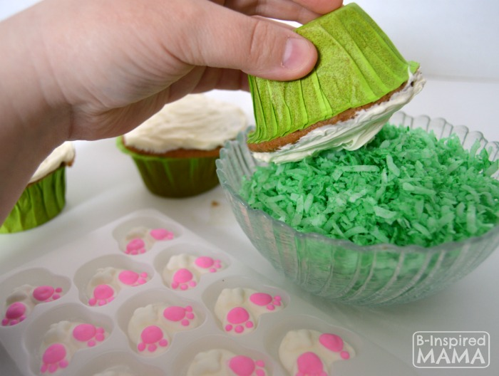 Icing and Decorating Bunny Nutt Easter Cupcakes - A Kids in the Kitchen Recipe at B-Inspired Mama