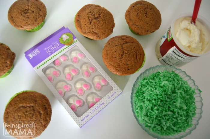 Icing our Bunny Nutt Easter Cupcakes - A Kids in the Kitchen Recipe at B-Inspired Mama