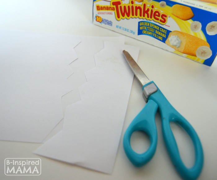 Cutting Paper Eggs - Hatching Chick Easter Treats using Twinkies at B-Inspired Mama