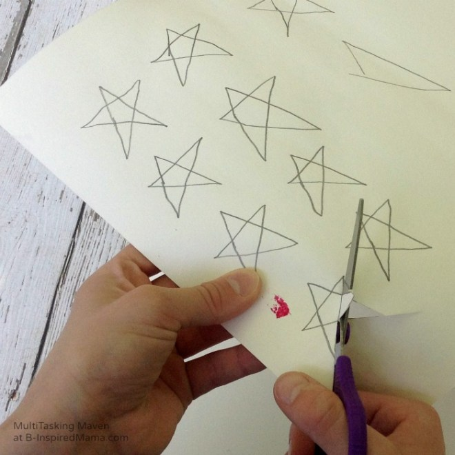 An Ice Paint American Flag Craft - Cutting Out Stars - B-Inspired Mama