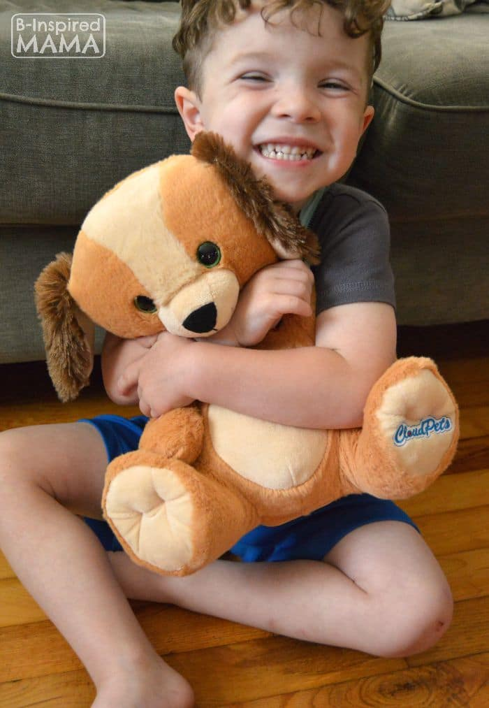 Keeping Your Blended Family Close - Even While Apart - J.C. hugging his New CloudPet - B-Inspired Mama