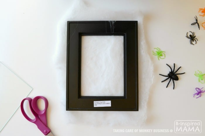Spider Web Picture Frame Halloween Craft - Adding the Spider Web - B-Inspired Mama