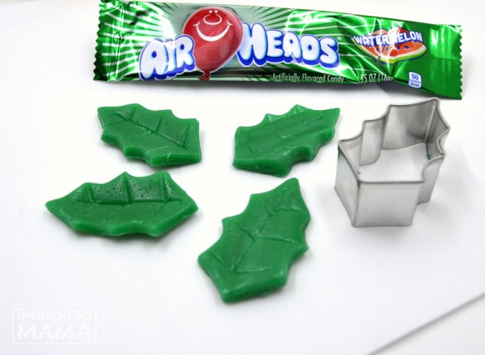 Make a Holly Cupcake Topper for Christmas Cupcakes - Using Watermelon Airheads for Holly - at B-Inspired Mama