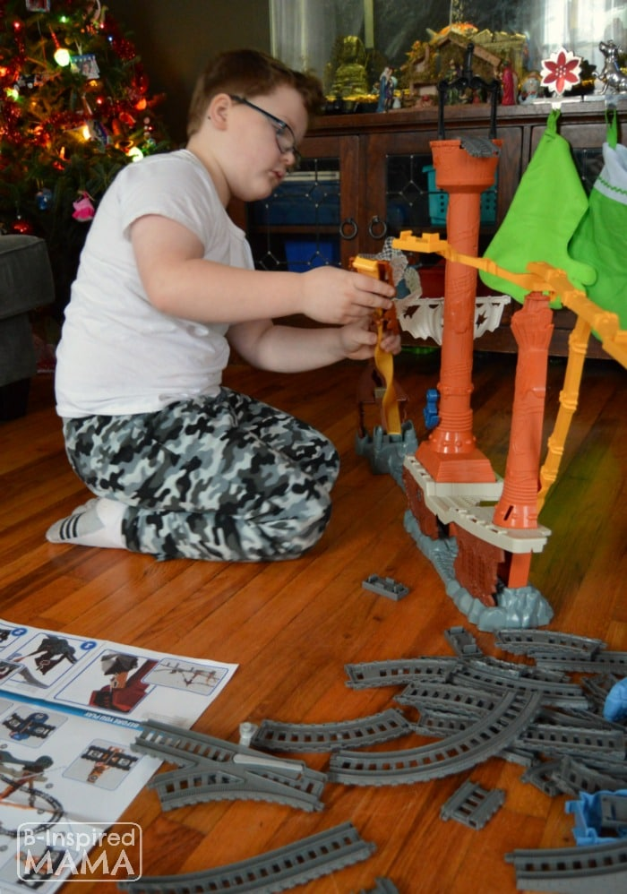 Sawyer Putting Together Our New Thomas Trackmaster Set + A Printable Train Ticket Holiday Gift Tag at B-Inspired Mama