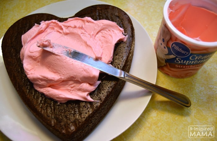Making Dark Chocolate Strawberry Brownies for Your Valentine - Adding Strawberry Frosting - B-Inspired Mama