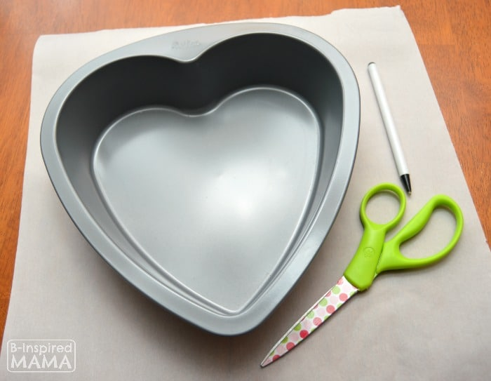 Making Dark Chocolate Strawberry Brownies for Your Valentine - Lining the Heart Shaped Pan - B-Inspired Mama