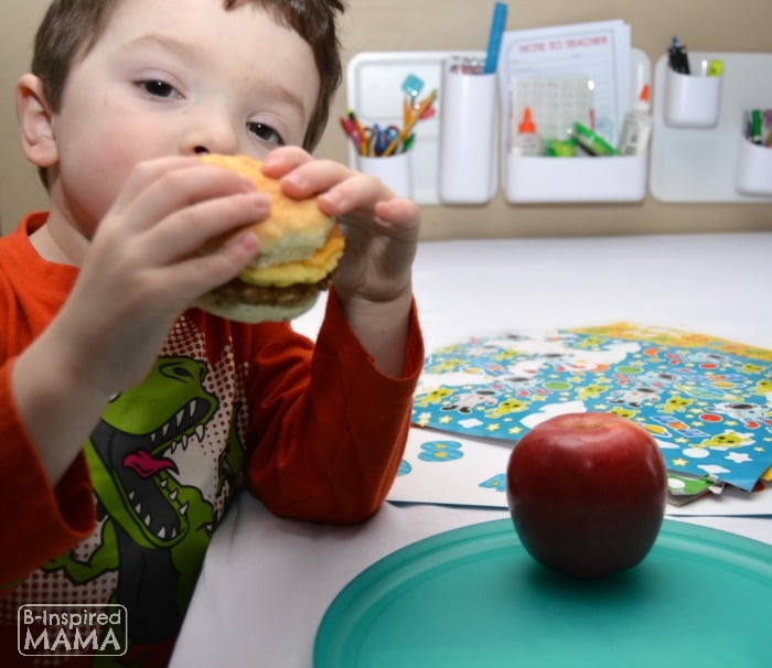 8 Simple School Morning Routine Tricks - JC with his Easy Freezer Breakfast Sandwich - at B-Inspired Mama