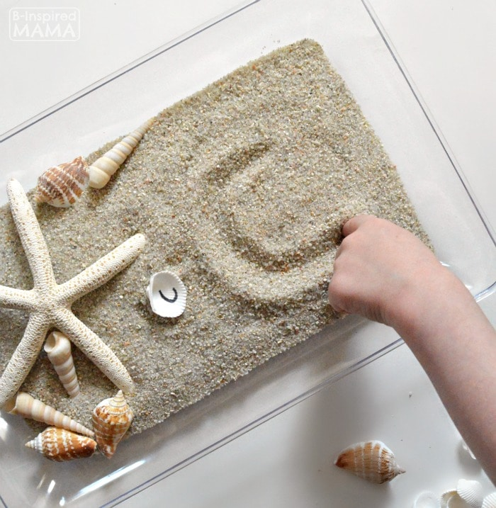 Learning the Alphabet with Seashells and Sand Sensory Writing - Practicing Handwriting Letters - at B-Inspired Mama