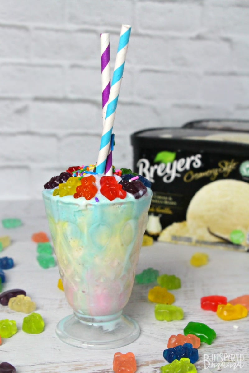 A super easy and seriously fun Rainbow Gummy Bear Milkshake Recipe - Make the kids smile this summer with a colorful and delicious milkshake - at B-Inspired Mama