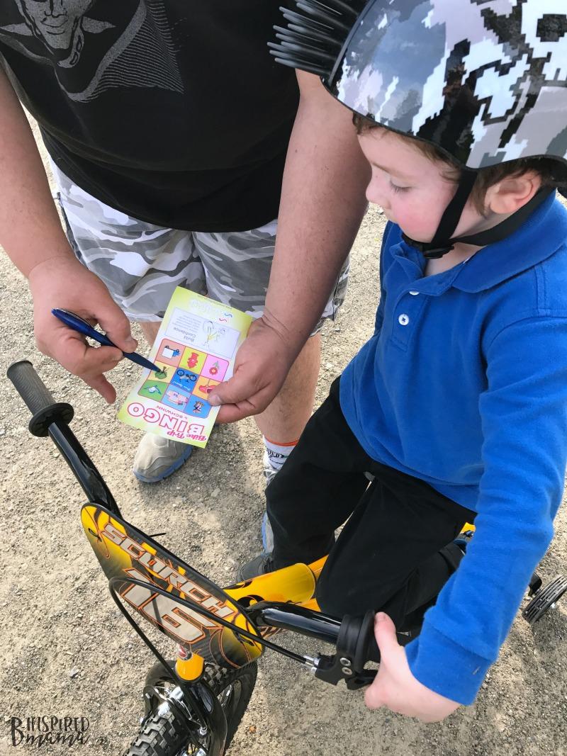 JC and his dad playing Kids Bike Bingo - Making Learning to Ride a Bike Fun