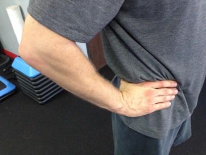Wrists on waist close up