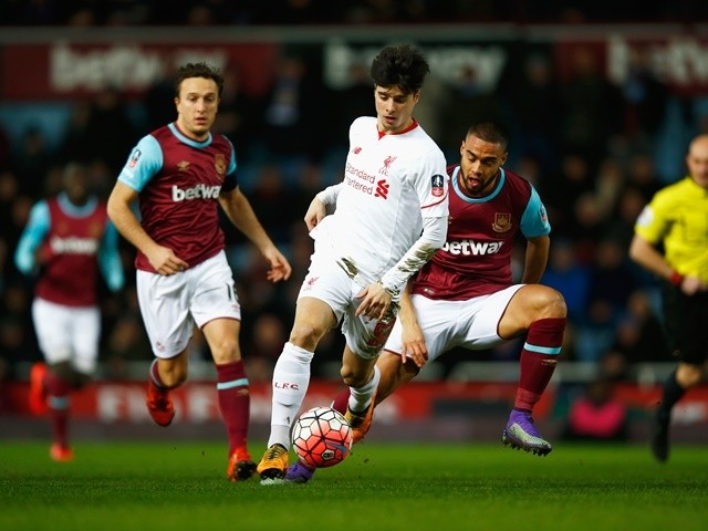 Joao Teixeira evades Mark Noble and Winston Reid during the FA Cup fourth-round replay between West Ham United and Liverpool on February 9, 2016