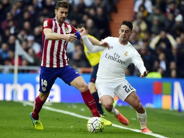 Gabi and Isco in action during the La Liga game between Real Madrid and Atletico Madrid on February 27, 2016