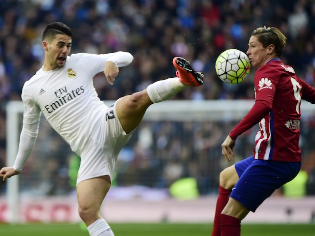 Isco and Fernando Torres in action during the La Liga game between Real Madrid and Atletico Madrid on February 27, 2016