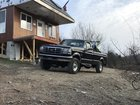 97' f250 with the 7.3 powerstroke sittin pretty with the bikes loaded in the bed.