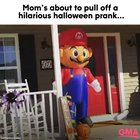 Mom hides in Super Mario blow up to scare her kid in epic Halloween prank