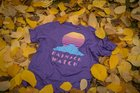 I designed a shirt inspired by outrun design. Then set it down in some leaves. 😎