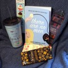 Win a signed paperback of There Are No Men, a Carpe Librum bookmark, magnetic cupcake book clips, a travel cup, and gourmet chocolate (10/31/2015)