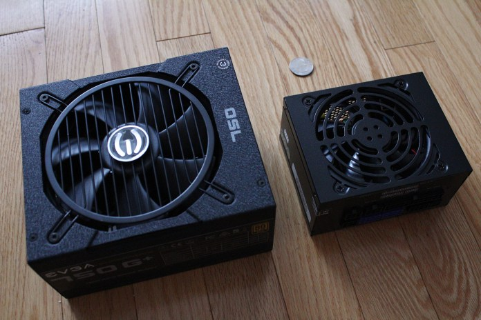 ATX PSU next to SFX PSU with a quarter nearby for scale, all on a wood floor
