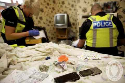 This photo shows some of the suspected drugs and items of interest seized by officers during an Operation Intrusive warrant that took place last Thursday.