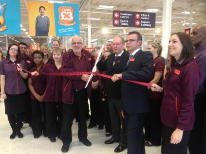 Manager Andy White, Acting Lord Mayor Mike Sharpe & fomer MG Rover worker and Sainsbury's colleague Ken Bullas officially open the store
