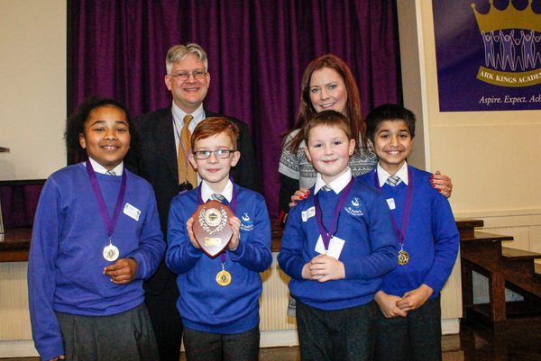 Team photo of pupils from St Jude's RC Primary School, winners of ARK Kings Academy's Primary School Mathematics Challenge 2015 with Principal Roger Punton (left)