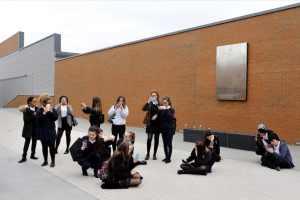 Turves Green Girls pupils looking at Longbridge through their smartphones