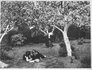 A family tending to one of the Bournville garden fruit trees