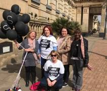 Supporters take their message to the council house