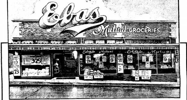 The logo for Eba's Mutual Groceries in 1936 is drawn over the front of their new Roosevelt Way store (January 31 1936 Seattle Times)