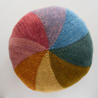 Colourwheel Cushion designed by Rebecca and knit in WildWestDye yarns. Photo courtesy of Rebecca Glazier.