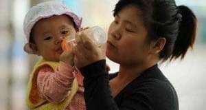 shanghai_woman_baby_afp-300x195.jpg