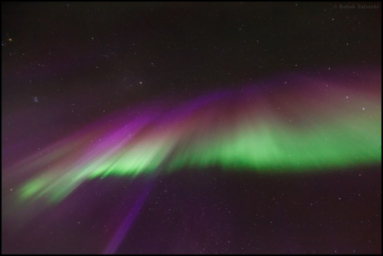 Colorful aurora crown or corona during an intense northern lights actvity.