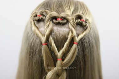 Three hearts are better than one! We love this twisted heart and 4 strand braid hairstyle from BabesInHairland.com. It's perfect for school Valentine's Day parties. hair | braids | love