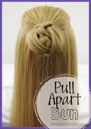 A new spin on a regular bun. Try this quick and easy pulled apart bun and you'll be out the door in no time. Your bun even has a surprise in the middle! BabesInHairland. #bun #hair #hairstyle #braid #easyhairstyle