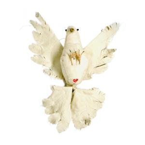 vogels duif van textiel liggend op haar rug