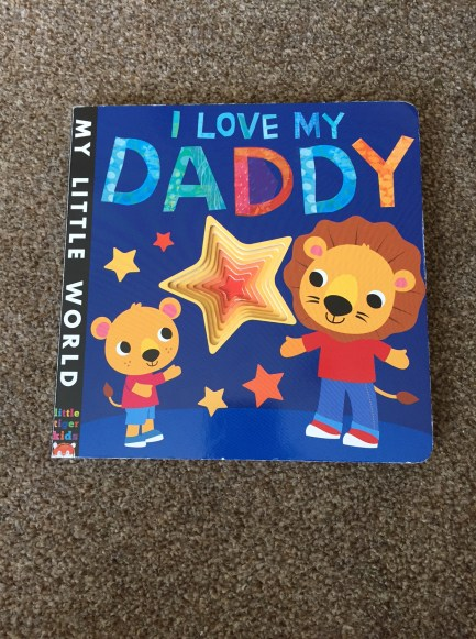 Front cover I Love My Daddy book with a big star in the middle and a Daddy lion and child lion on the front
