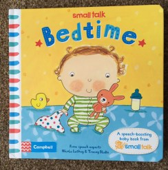 Front cover of Bedtime book - yellow and blue background with a cartoon baby holding a blanket and teddy bunny, with a milk bottle and rubber duck on either side