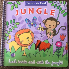 Front cover of touch & feel Jungle book. Brightly coloured with a lion,monkey and lots of plants.