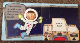 Page of Space book with an illustration of an astronaut looking out a window. there's a with an illustration of a control board, the page is also a flap saying 'what is there?'