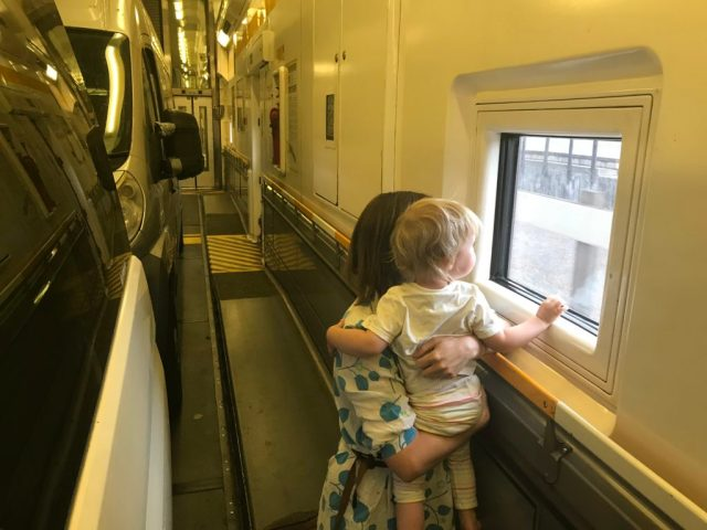 A mother and toddler look out of the window on a Eurotunnel train