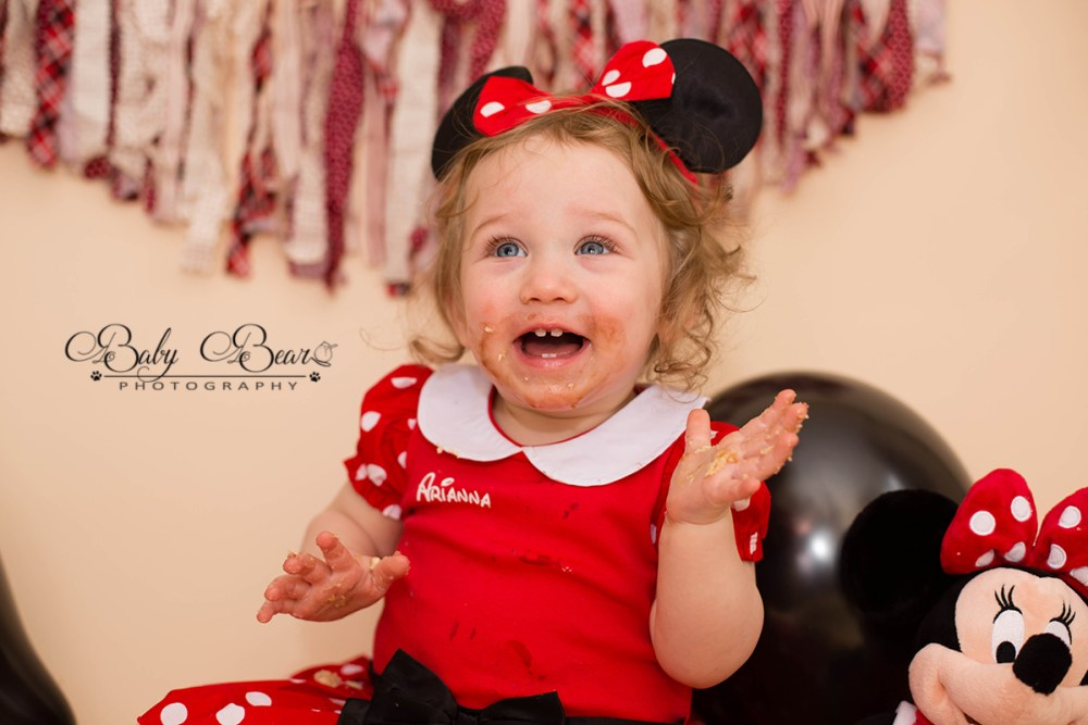 cute baby girl in her cake smash photoshoot coventry