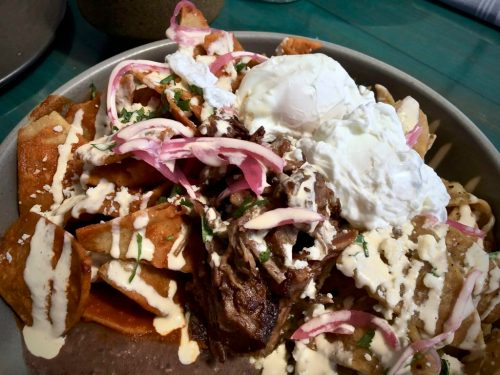 Chilaquiles Divorciados topped with short rib at El Jardin in San Diego